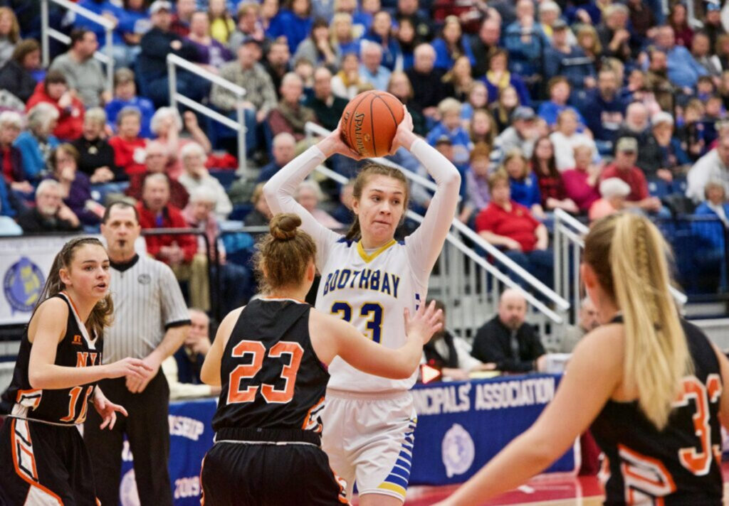 Boothbay's Faith Blethen looks to make a pass over North Yarmouth Academy's Serena Mower during the Class D South final Saturday in Augusta.