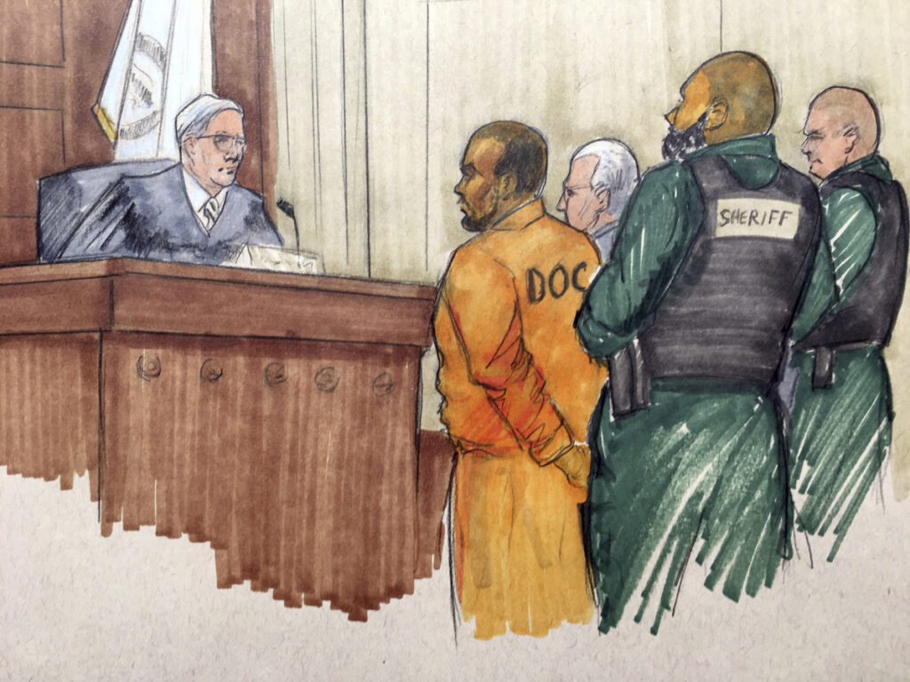 In this courtroom sketch, R&B singer R. Kelly appears before Cook County Associate Judge Lawrence Flood with his attorney Steve Greenberg on Monday at the Leighton Criminal Courthouse in Chicago. Kelly's attorney entered not guilty pleas on the singer's behalf after Kelly was charged with sexually abusing four victims dating back to 1998, including three underage teenagers.