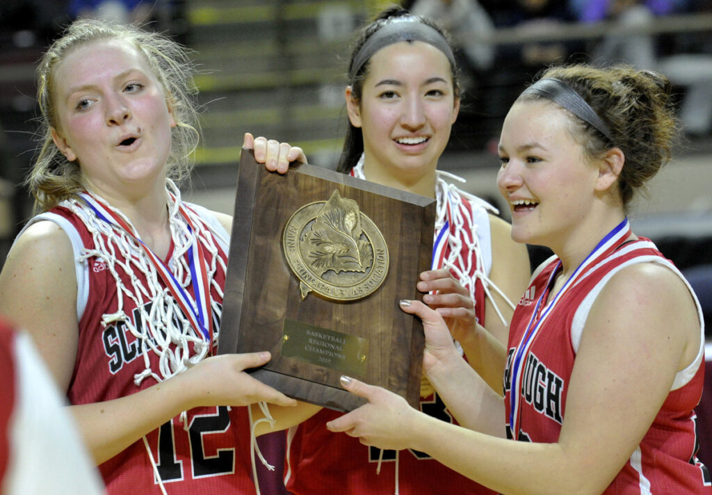 Madison Blanche, center, celebrates with teammates Josie Couture, left, and Leah Dickman after Scarborough won the Class AA South title on Friday. Blanche scored 16 points, taking Coach Mike Giordono's direction to look for her shot – and take it – more often.