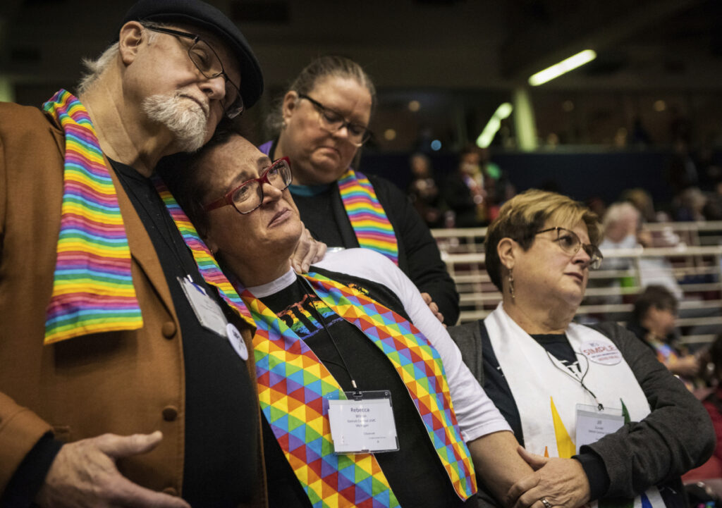 Ed Rowe, left, Rebecca Wilson, Robin Hager and Jill Zundel react to the defeat of a proposal that would allow LGBT clergy and same-sex marriage within the United Methodist Church, at the denomination's 2019 Special Session of the General Conference in St. Louis, Mo., on Tuesday.