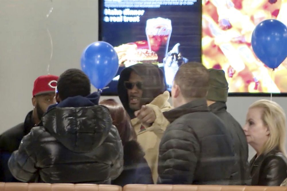 R. Kelly stopped at a McDonald's restaurant in Chicago on Monday after a suburban Chicago woman posted the $100,000 bail for him to be freed from jail while he awaits trial on sexual abuse charges. (WFLD via AP)