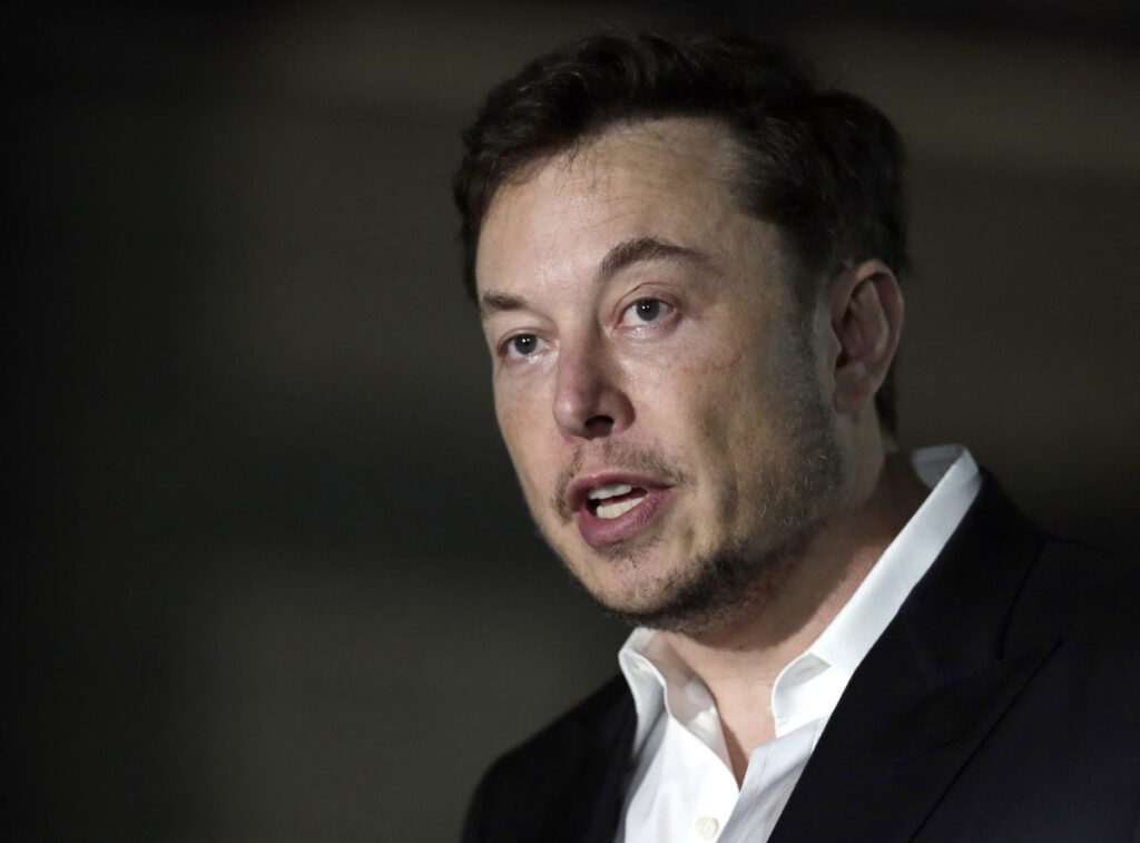 The Securities and Exchange Commission sought an order following a Feb. 19 tweet from Tesla CEO Elon Musk about auto production numbers that was not approved by a Tesla lawyer. Under a settlement from October related to a previous tweet, Musk's tweets must be OK'd by the lawyer if there is potential for the message to influence the company's stock price.   (AP Photo/Kiichiro Sato, File)