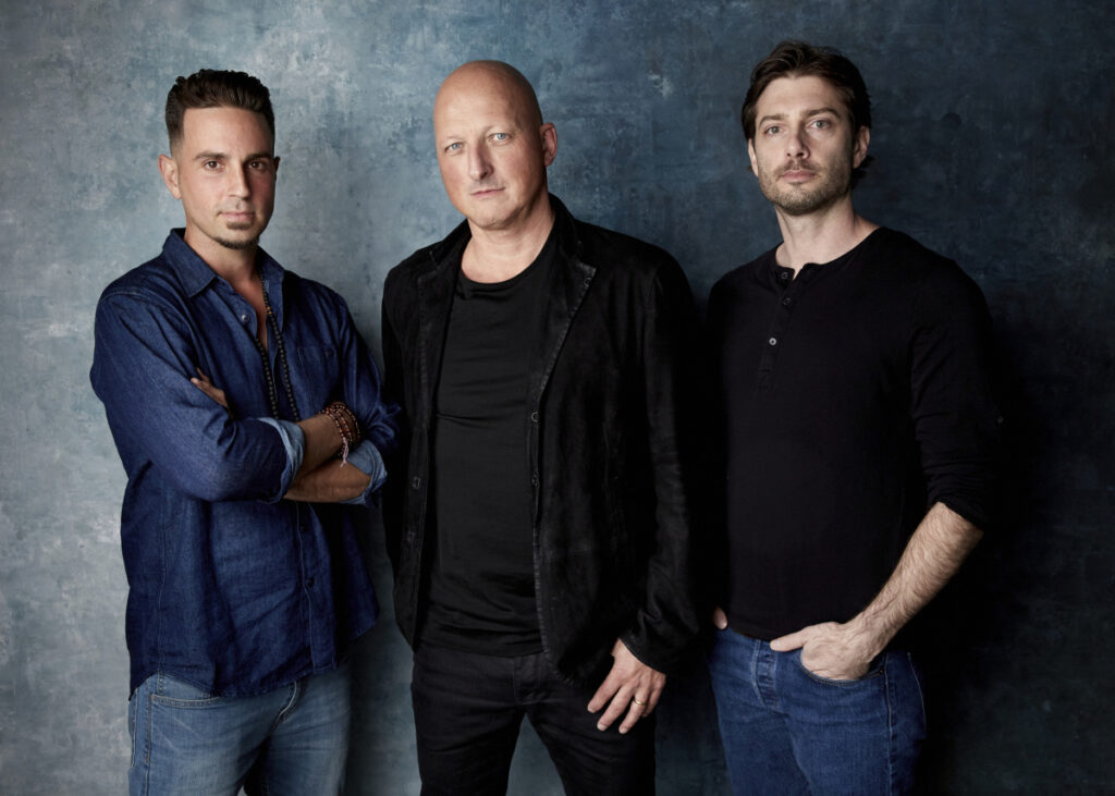 "Wade Robson, from left, director Dan Reed and James Safechuck pose for a portrait to promote the film ""Leaving Neverland"" during the Sundance Film Festival in Park City, Utah. The documentary, which premiered at the festival to a standing ovation, will begin airing on HBO on Sunday."