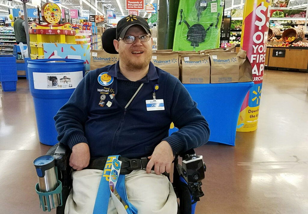 Greeter John Combs works at a Walmart store April 21 in Vancouver, Wash. Combs, who has cerebral palsy, and other greeters with disabilities are threatened with job loss as Walmart transforms the greeter position into one that's more physically demanding. Combs was devastated and then angered by his impending job loss.