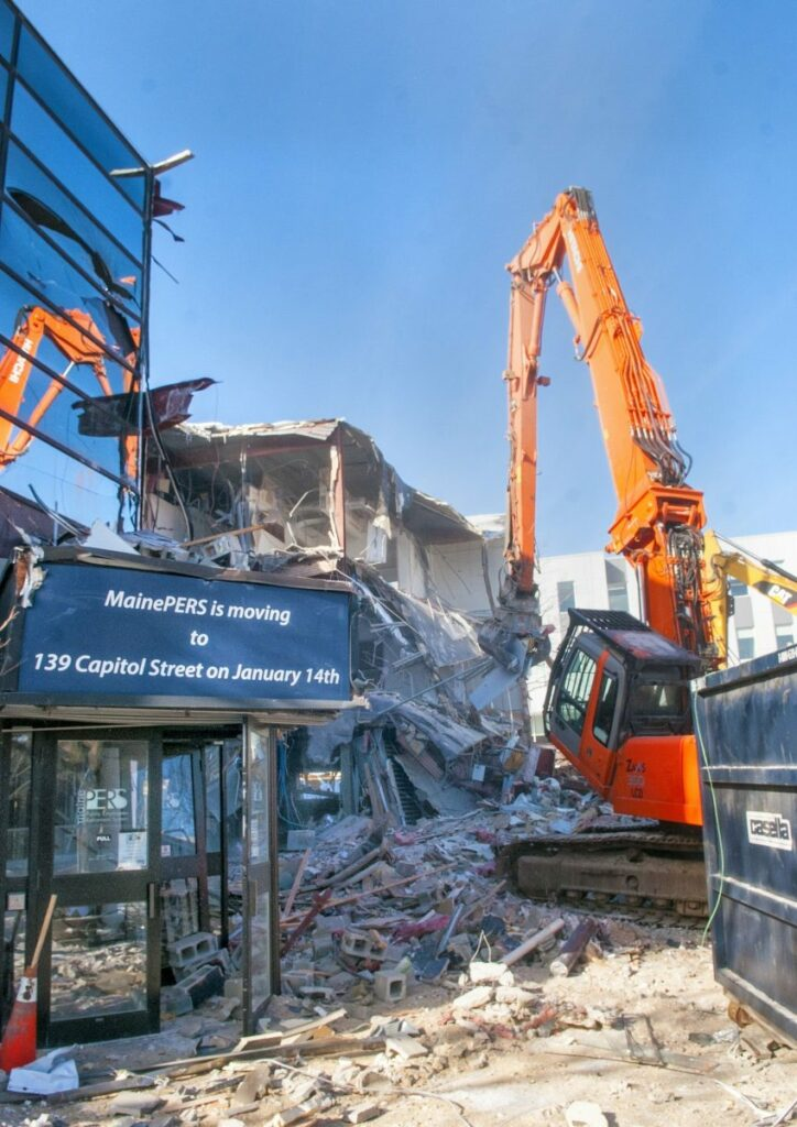 Kennebec Journal photo by Joe Phelan Excavators tear apart the old Maine Public Employees Retirement System building on Wednesday at the corner of Sewall and Capitol streets near the Maine State House in Augusta.