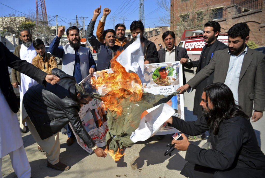 Pakistani protesters burn an effigy of Indian Prime Minister Narendra Modi during a rally in Peshawar, Pakistan, on Wednesday.