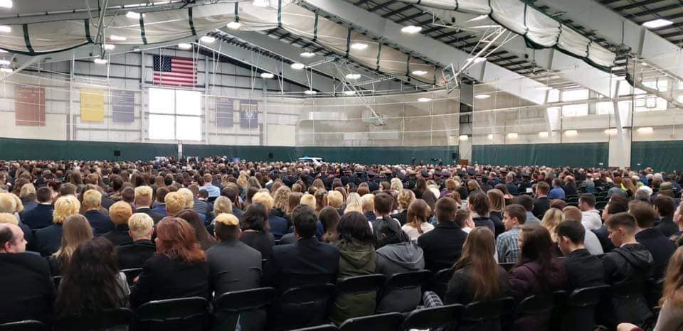 """The field house at the University of Southern Maine was filled by close to 2,500 people Thursday for the funeral of Wayne """"Pooch"""" Drown."""