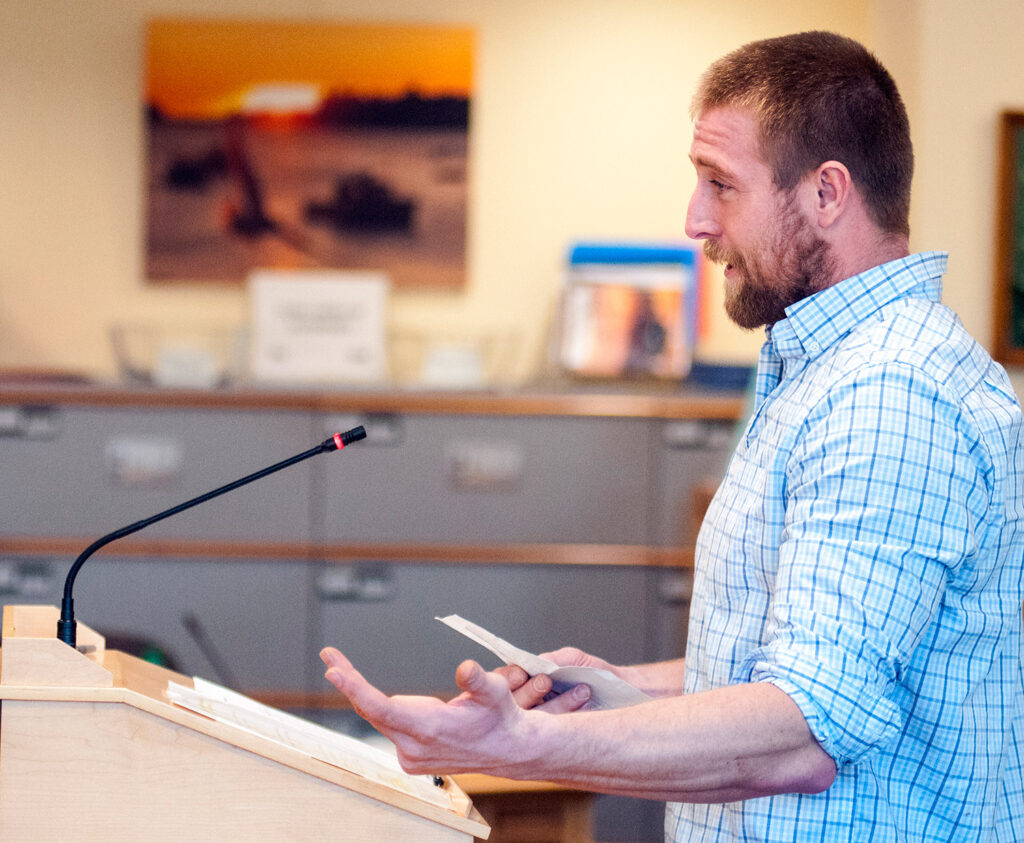 Joshua Kane of Bar Harbor, who said he's been on a wait list for a lobster license for nine years, testifies Tuesday in favor of the bill to give a license to anyone who has completed the state apprentice program and waited for 10 years or more.