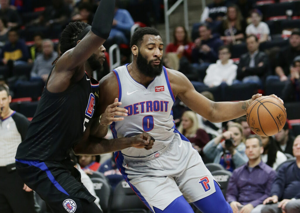 Detroit Pistons center Andre Drummond drives to the basket against Los Angeles Clippers forward Montrezl Harrell during the first half Saturday in Detroit.