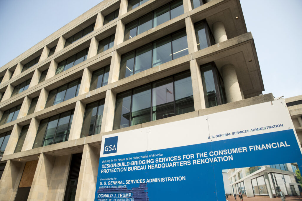 In this Aug. 27, 2018, file photo a sign stands at the construction site for the Consumer Financial Protection Bureau's new headquarters in Washington. The nation's federal financial watchdog has announced its plans to roll back most of its consumer protections governing the payday lending industry. It's the Consumer Financial Protection Bureau's first rollback of regulations under its new Director, Kathy Kraninger, who took over the bureau late last year.