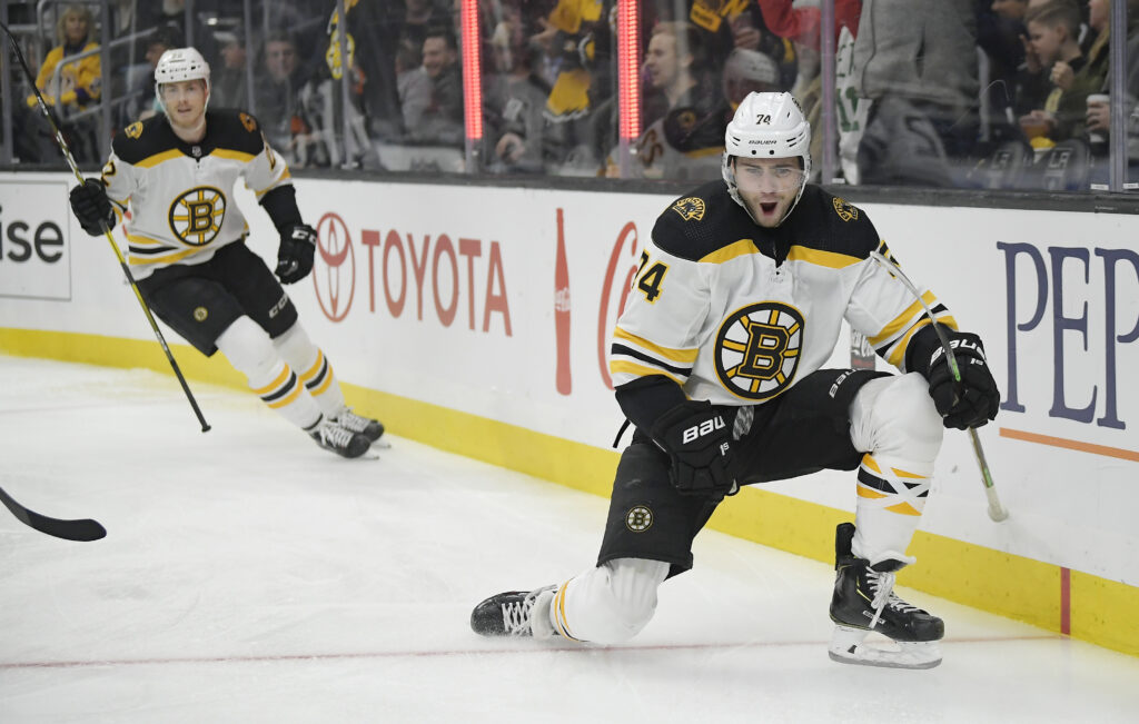 Boston Bruins left wing Jake DeBrusk, right, and left wing Peter Cehlarik celebrate DeBrusk's goal during the first period of the Bruins' 4-2 win over the Los Angeles Kings on Saturday in Los Angeles.