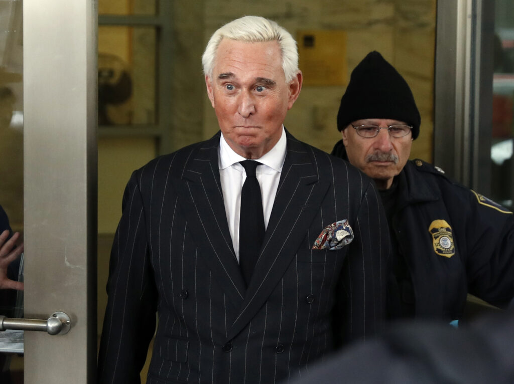 "In this Feb. 1, 2019, file photo, former campaign adviser for President Donald Trump, Roger Stone, leaves federal court in Washington. President Donald Trump's longtime confidant Stone has apologized to the judge presiding over his criminal case for an Instagram post featuring a photo of her with what appears to be the crosshairs of a gun. Stone and his lawyers filed a notice Monday night, Feb. 18, saying Stone recognized ""the photograph and comment today was improper and should not have been posted."""