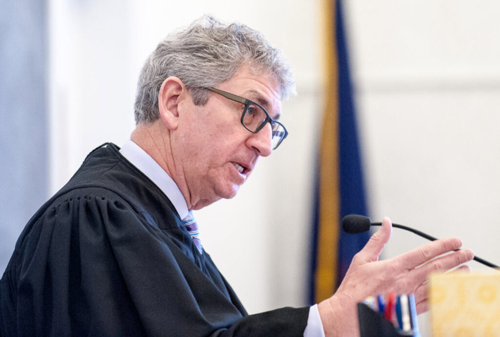 """Justice William Stokes delivers his verdict in Franklin County Superior Court on Friday morning, finding James """"Ted"""" Sweeney guilty of murder."""
