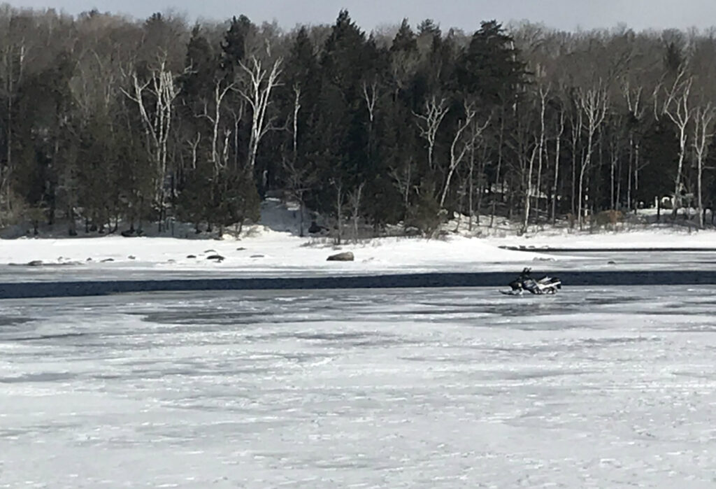 A snowmobile owned by Nicholas Smith of Berwick who escaped without injury during last night's rescue on Sebec Lake. The incident took place about  a half-mile West of Sebec Lake Dam.