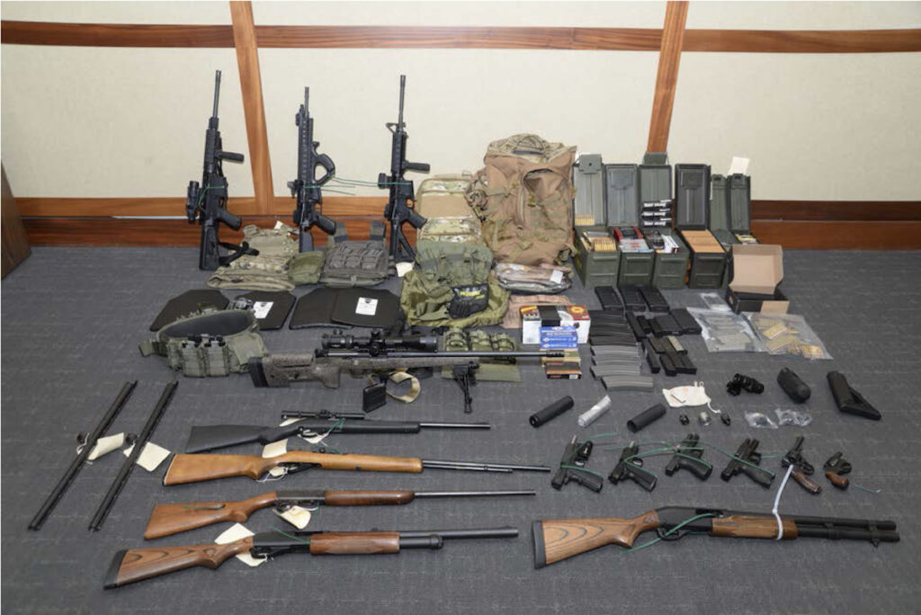 A photo of firearms and ammunition that was in the motion for detention pending trial in the case against Christopher Paul Hasson.