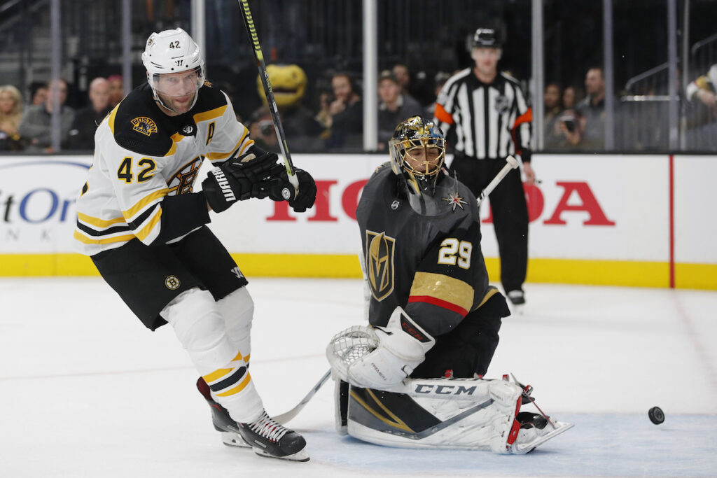 Boston Bruins right wing David Backes (42) scores on Vegas Golden Knights goaltender Marc-Andre Fleury (29) during the shootout on Wednesday.