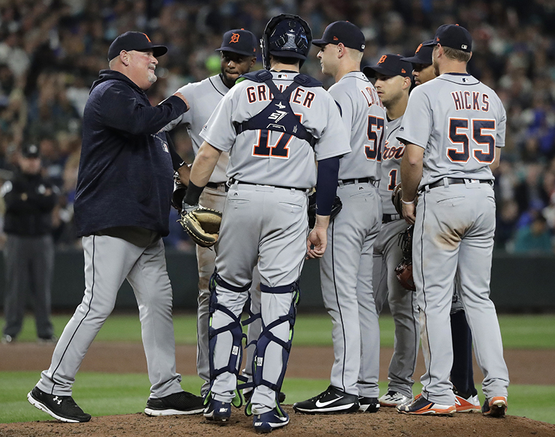 Detroit Tigers pitching coach meet at the mound in May 2018. Under proposed rules, the number of trips to the mound would be reduced from six to five.