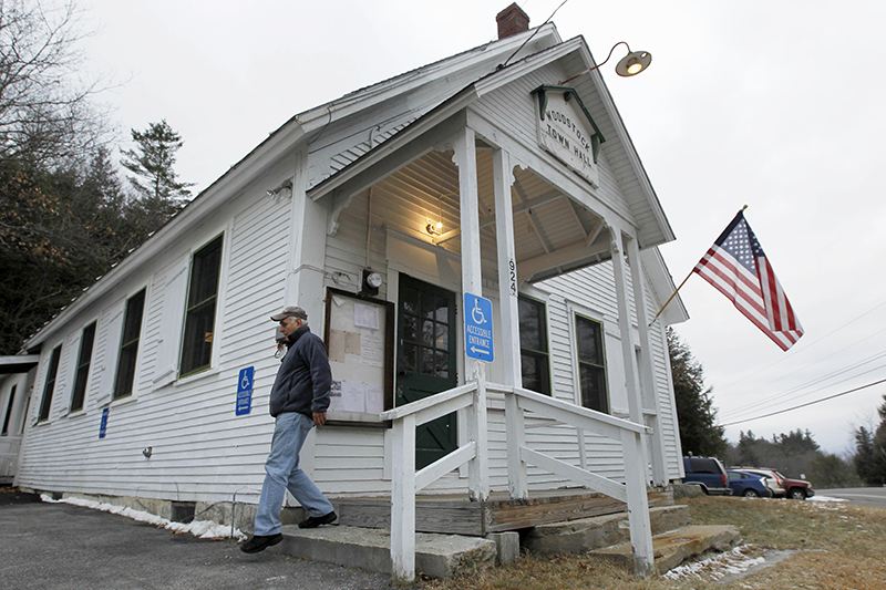 A voter exits the Woodstock Town Hall in New Hampshire in 2012.