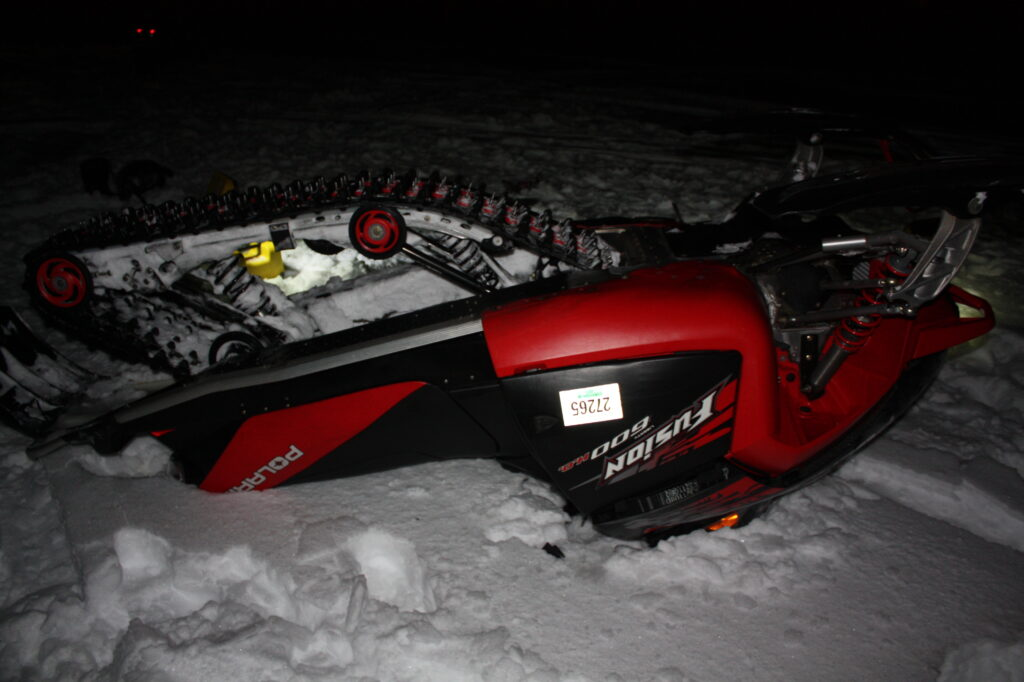 An overturned snowmobile is at the scene of a wreck in Norway that killed the driver.