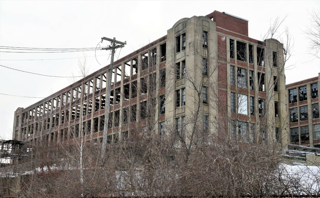 The 35-day partial shutdown of the federal government meant a projected January start for removal of asbestos and later demolition of the rear tower of the Stenton Trust building in Sanford,  shown here, couldn't begin on schedule, but the U.S. Environmental Protection Agency says residents should begin to see activity at the site beginning in March.