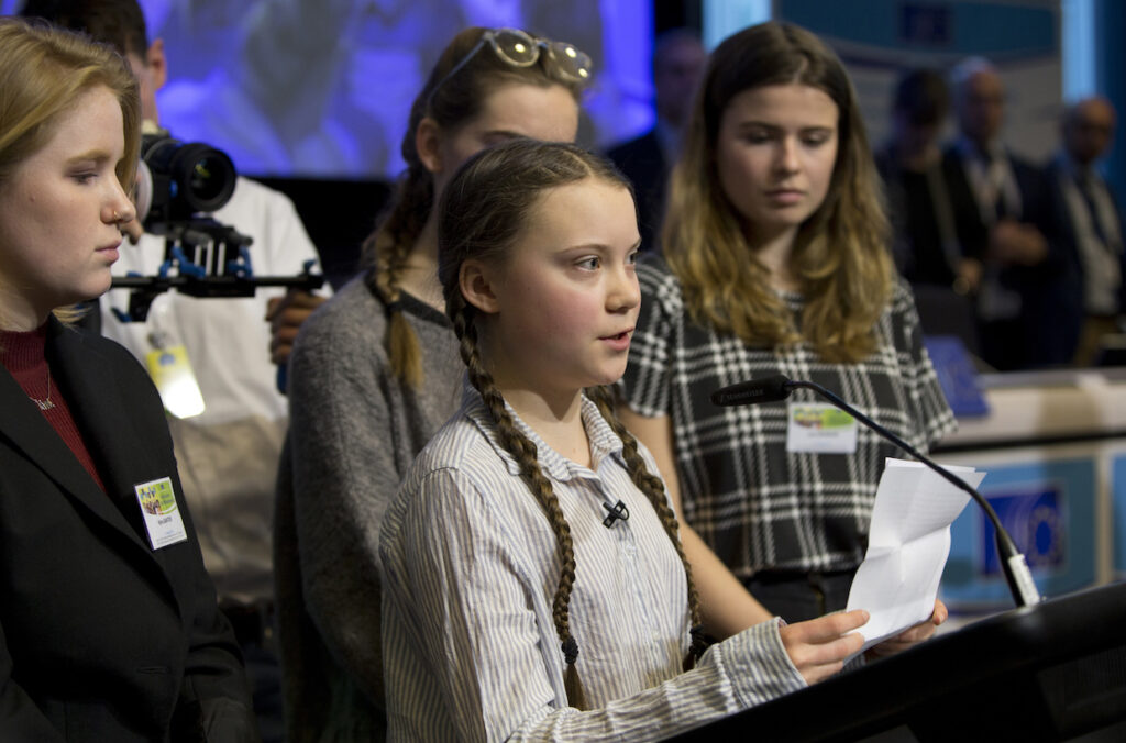 Swedish climate activist Greta Thunberg, center, speaks during an event at the EU Charlemagne building in Brussels on Thursday.