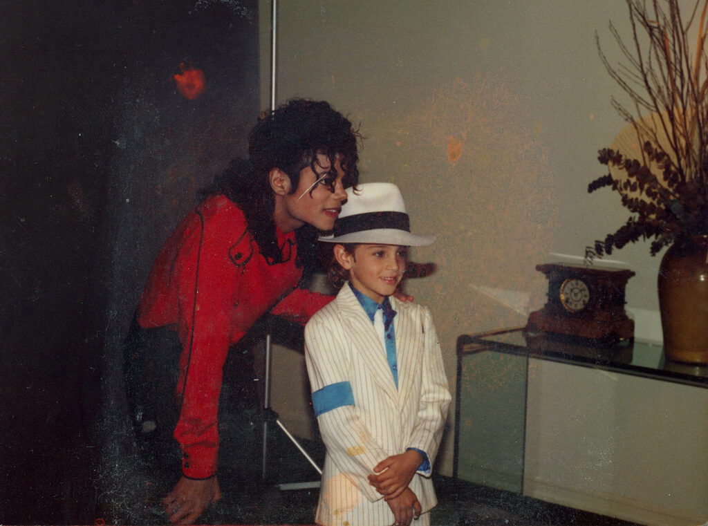 Michael Jackson poses for a photo with a young Wade Robson.
