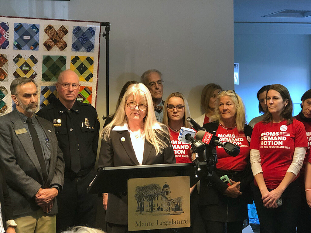 "Sen. Rebecca Millett, D-Cape Elizabeth, addresses supporters of a new ""red flag"" bill that she is sponsoring, during a press conference Tuesday at the State House."