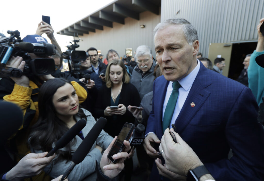 Washington Gov. Jay Inslee answers questions from reporters Friday after speaking at a campaign event at A&R Solar in Seattle. Inslee announced that he will seek the 2020 Democratic presidential nomination, mixing calls for combating climate change and highlights of his liberal record with an aggressive critique of President Trump.