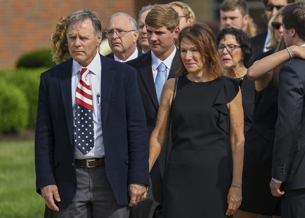 "Fred and Cindy Warmbier watch as their son Otto's casket is placed in a hearse after his funeral Wyoming, Ohio, on June 22, 2017. The Warmbiers spoke out Friday after President Trump's comment this week that he takes North Korean leader Kim Jong Un ""at his word"" that he was unaware of any mistreatment during their son's 17 months of captivity. Warmbier died at age 22 soon after his return home in June 2017."