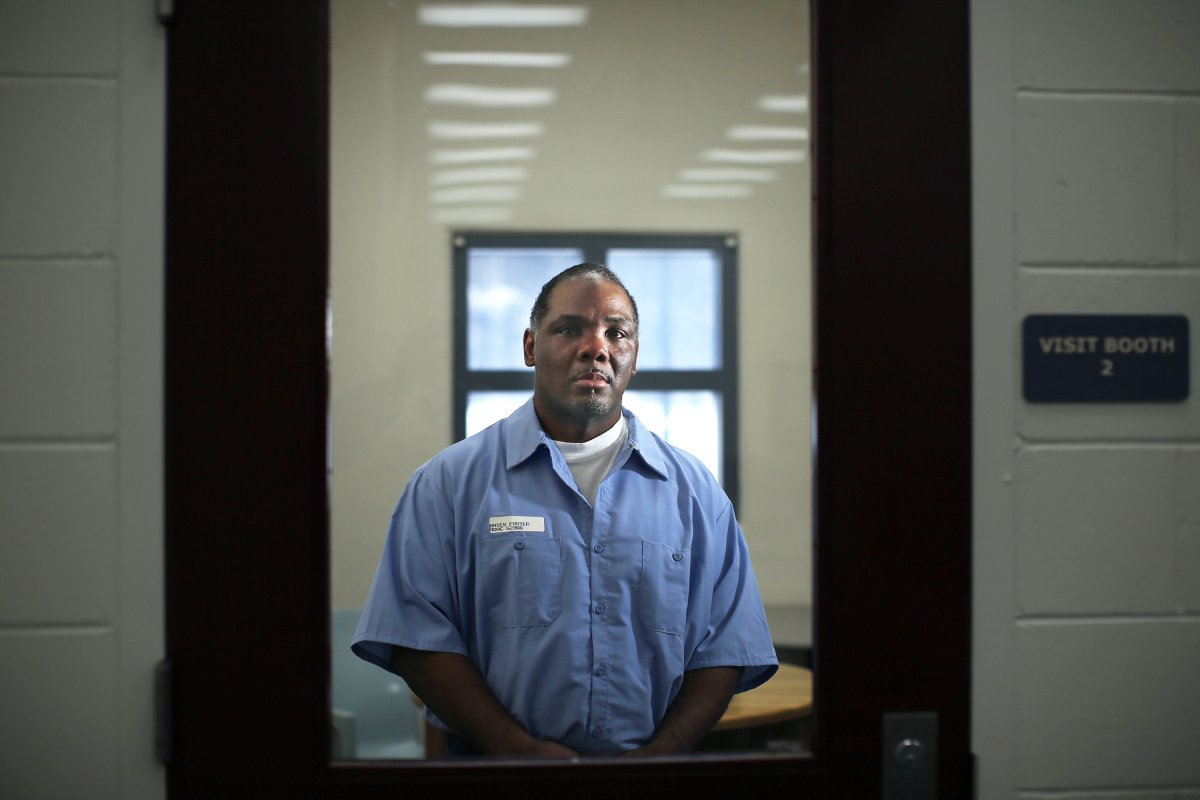Foster Bates poses for a portrait last month in a visiting room at the Maine State Prison in Warren. Bates has been serving a life sentence since he was convicted in 2002 of raping and murdering a South Portland woman. He has maintained his innocence from the start and has been pushing for a new trial.