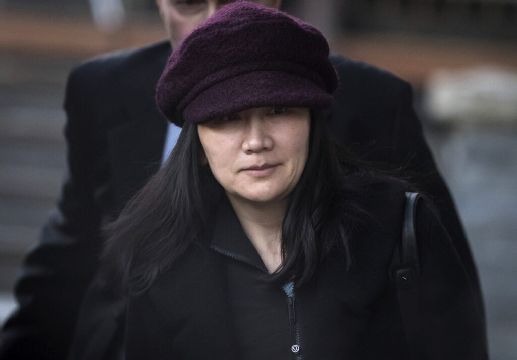 Huawei chief financial officer Meng Wanzhou leaves her home to attend a court appearance in Vancouver, British Columbia, on Jan. 29. Canada said Friday it will allow the U.S. extradition case against Meng to proceed. She is due in court on March 6, at which time a date for her extradition hearing will be set. Meng is wanted in the U.S. on fraud charges that she misled banks about the company's business dealings in Iran.