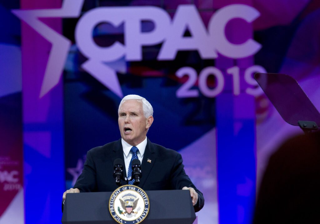 "Vice President Mike Pence speaks at the Conservative Political Action Conference in Oxon Hill, Md., on Friday. ""The moment America becomes a socialist country is the moment America ceases to be America,"" he told the crowd of conservative activists."