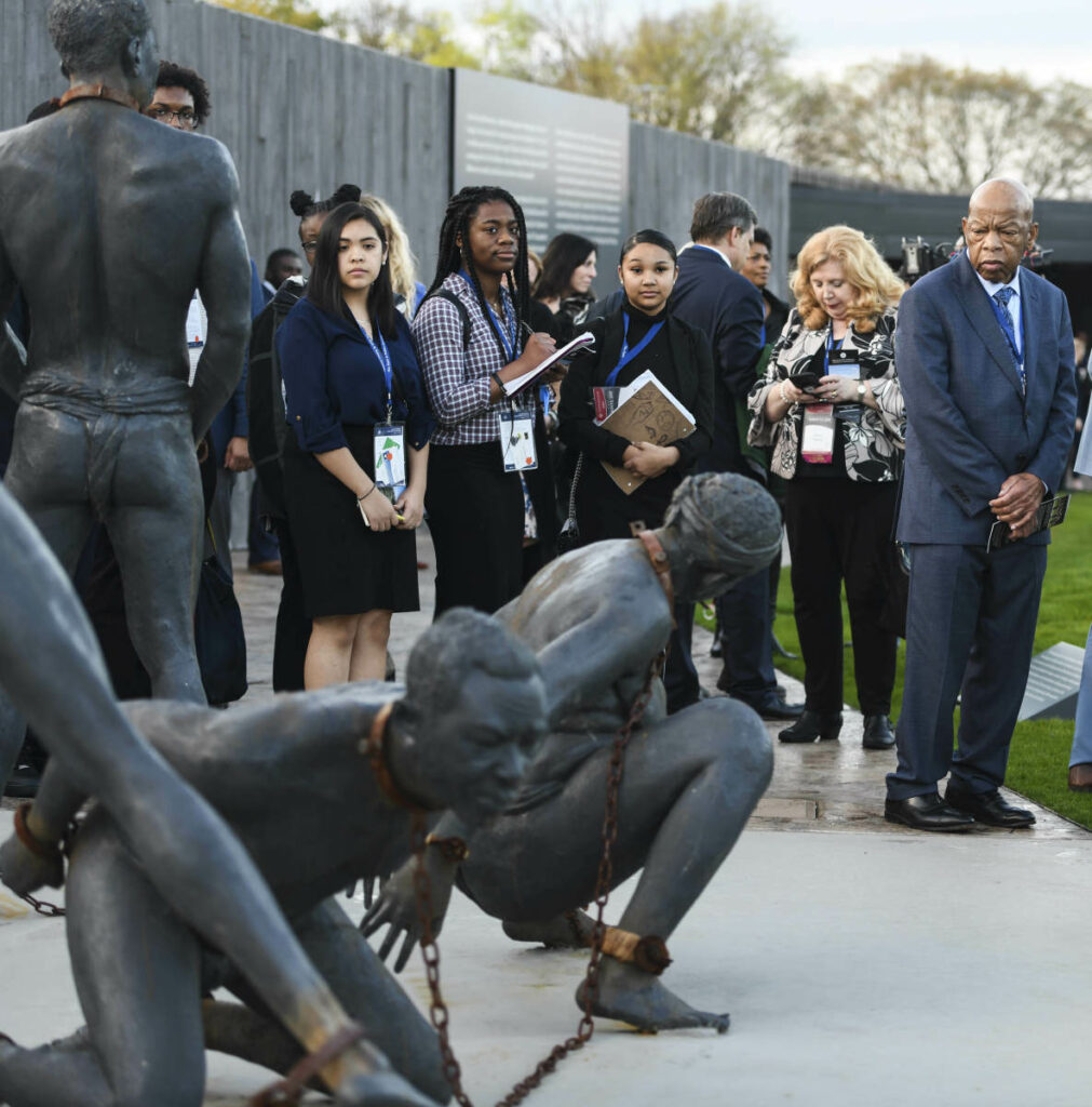 U.S. Rep. John Lewis, D-Ga., far right, tours the National Memorial for Peace and Justice in Montgomery, Ala., during a stop Friday on the Congressional Civil Rights Pilgrimage.