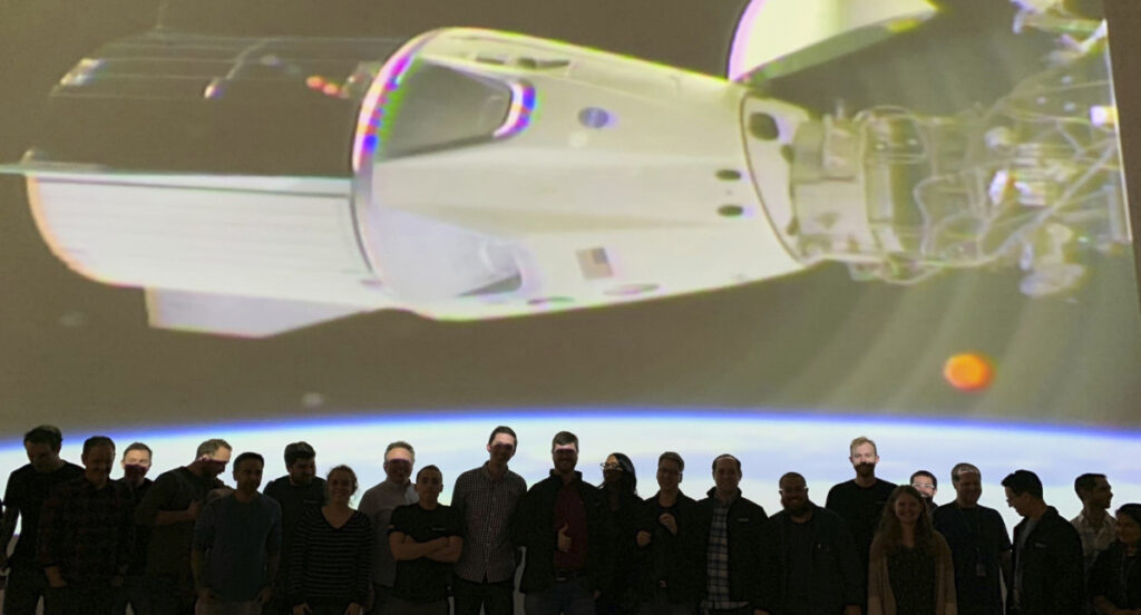 The SpaceX team in Hawthorne, Calif., watches as the Dragon capsule docks with the International Space Station on Sunday.
