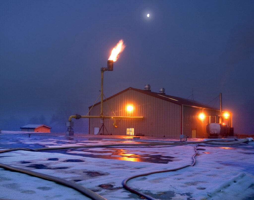 Unused methane gas, not consumed by Qualco's powerhouse, flames off a giant stack outside the facility near Monroe, Wash., in 2012.