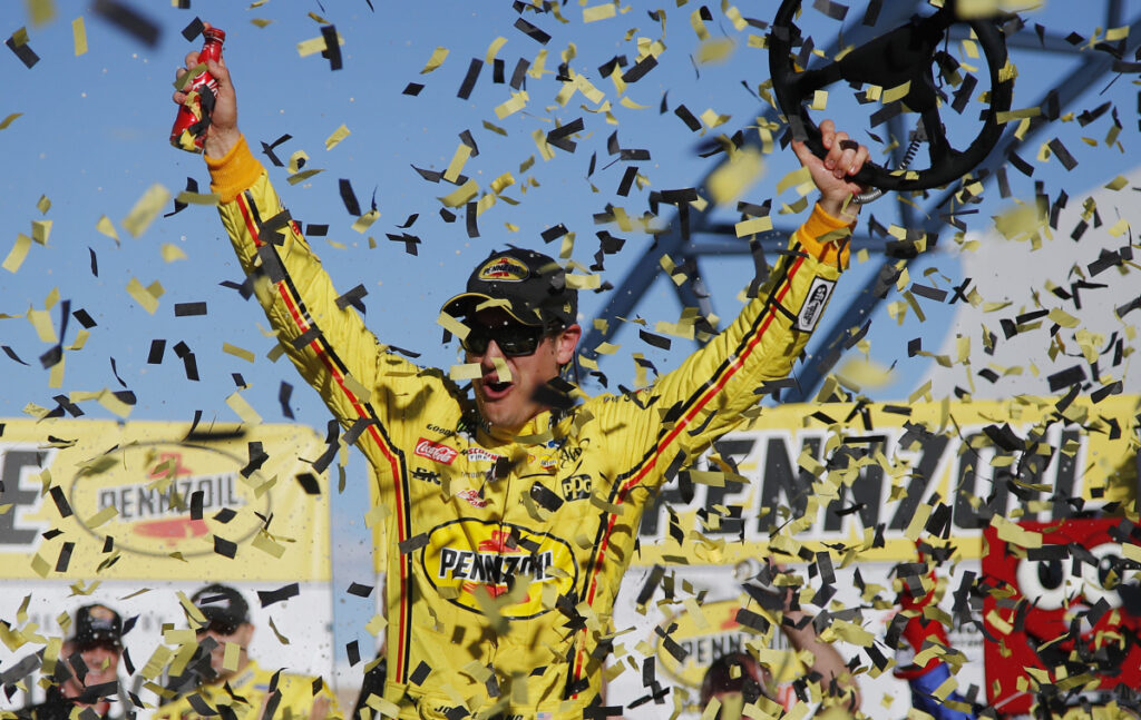 Joey Logano celebrates after holding off Brad Keselowski to win the NASCAR Cup Series race Sunday in Las Vegas.