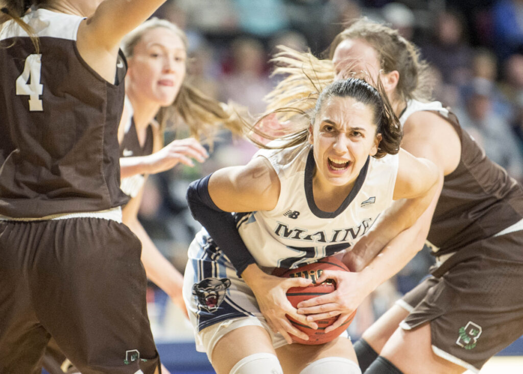 BANGOR,  ME - DECEMBER 8, 2018   University of Maine's Blanca Millan (22) battles for the ball with Brown University's with Brown University's Erika Steve (31) at the Cross Insurance Center in Bangor on Saturday, Dec. 8, 2018. Maine defeated Brown 102-96 in overtime advancing to 7-2 on the season.  (Staff Photo by Michael G. Seamans/Staff Photographer)