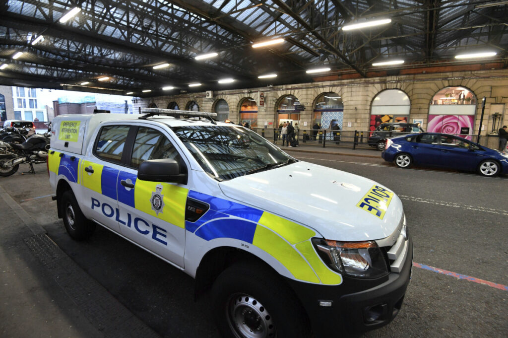 A British Transport Police vehicle is seen at Waterloo Railway Station on Tuesday after three small improvised explosive devices were found at buildings at Heathrow Airport, London City Airport and Waterloo in London.