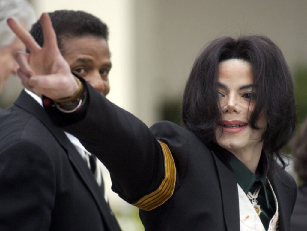 "Michael Jackson waves to his supporters as he arrives for his child molestation trial in Santa Maria, Calif., in 2005. ""Leaving Neverland,"" an HBO documentary, focuses on the abuse allegations of two men, Wade Robson and James Safechuck."