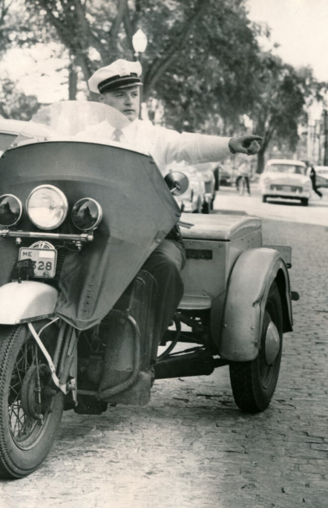 Herve Gendreau, a former chief with the Lewiston Police Department, rides a three-wheeler on Park St. in 1960 as part of the department's traffic division. Gendreau passed away on Friday at the age of 88. Submitted photo