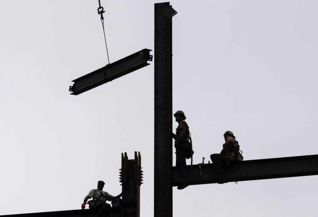 Ironworkers construct a commercial and residential building in Philadelphia in June 2018.