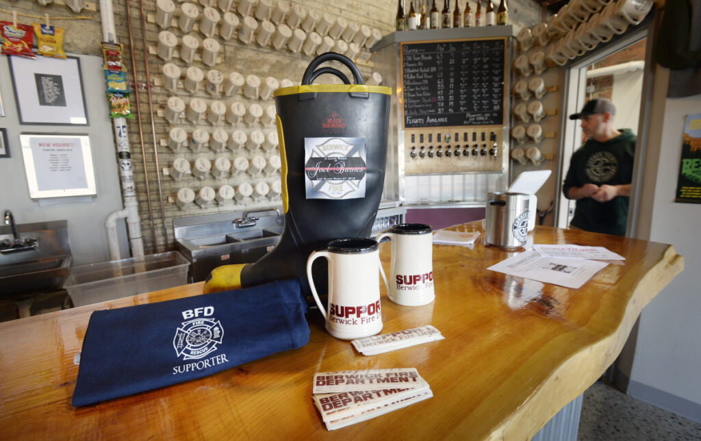 Berwick's Corner Point Brewing Co. has a boot on the bar for donations to the Berwick Fire Department, which lost 32-year-old paramedic Joel Barnes to a fire Friday.