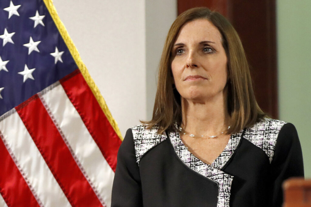 Sen. Martha McSally, R-Ariz., the first female fighter pilot to fly in combat, says she stayed silent for years after being raped by an Air Force superior officer because she did not trust the system.