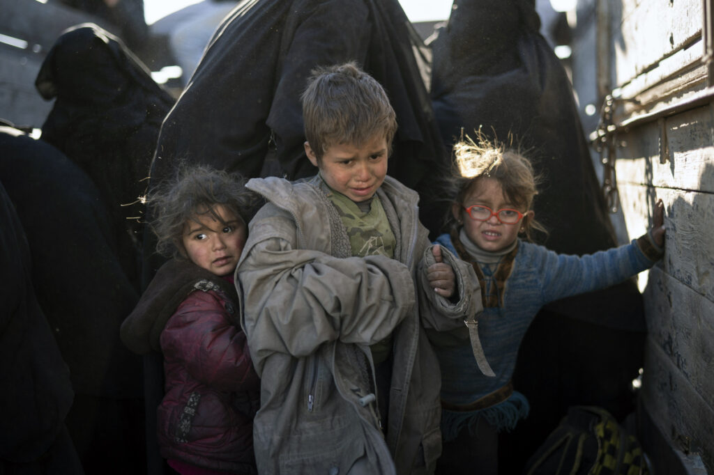 Desperate and hungry, women and children arrive at a screening area outside Baghouz, Syria, where the remnants of Islamic State are still holding out.