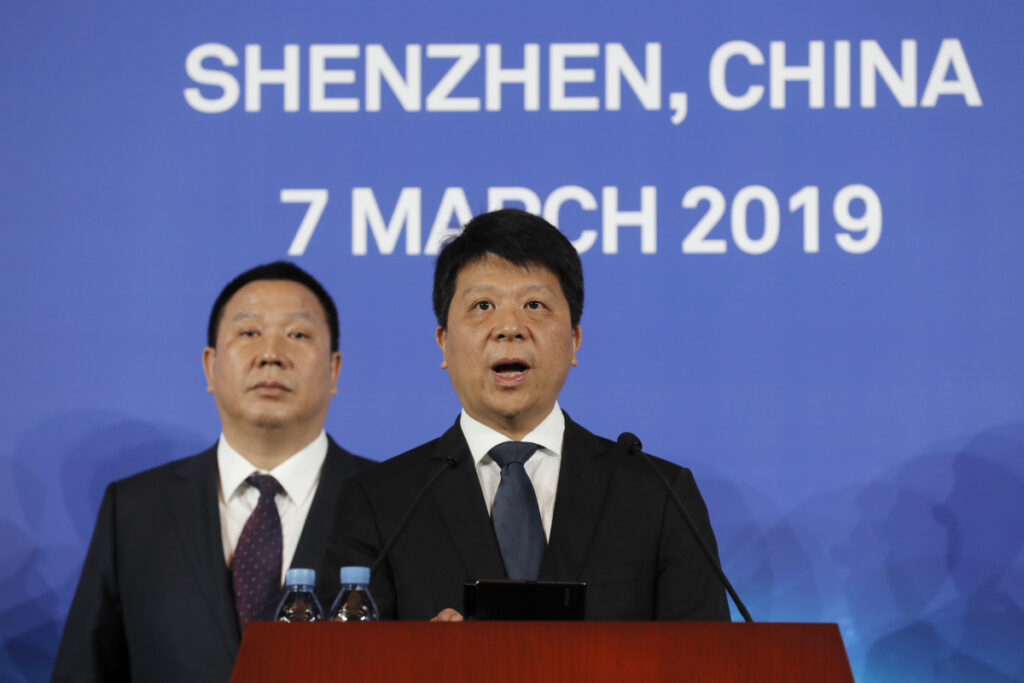 "Huawei Rotating Chairman Guo Ping, center, appeared at a press conference Thursday in Shenzhen, China, as the company launched a lawsuit in Plano, Texas, the headquarters of Huawei's U.S. operations. Guo said the company was ""compelled to take this legal action"" to protect its position in the global marketplace. Associated Press/Kin Cheung"