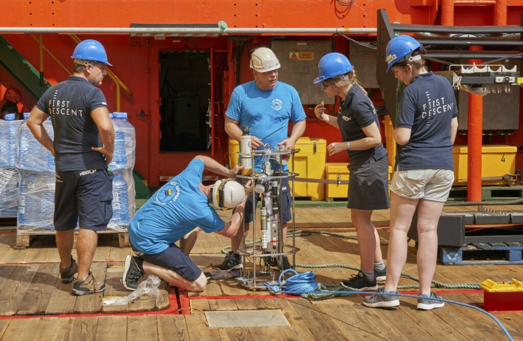 Researchers prepare to launch a water measurement device as the British-led Nekton Mission begins in the tiny Alphonse atoll in the Seychelles on Thursday.