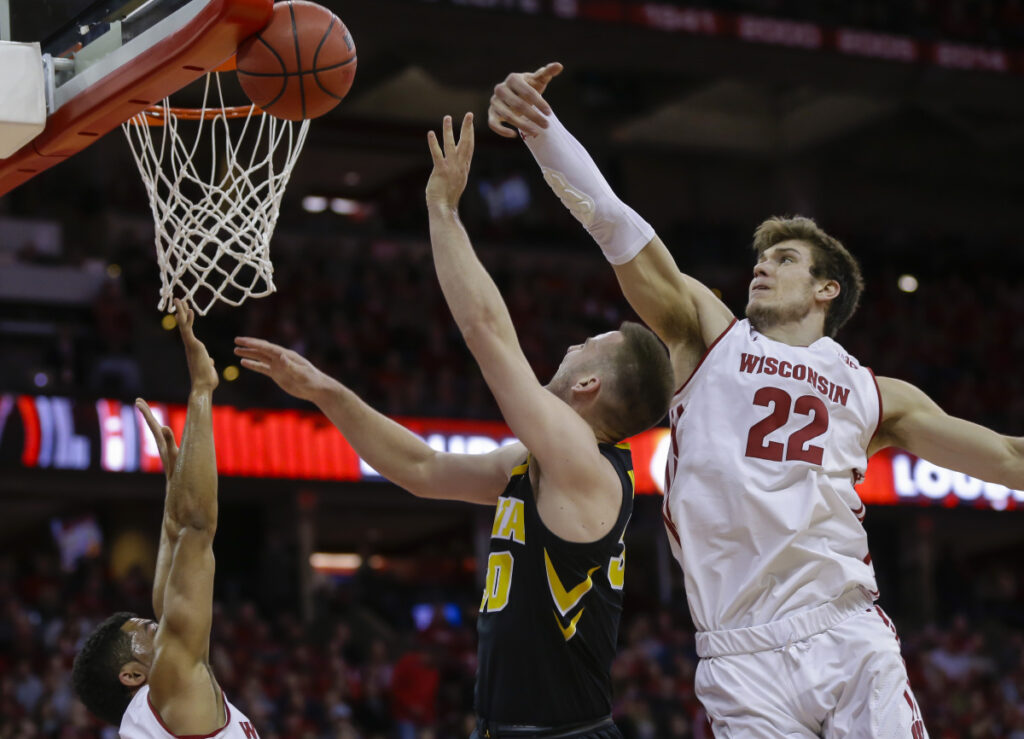 Wisconsin's Ethan Happ, right, blocks a shot by Iowa's Connor McCaffery during Wisconsin's 65-45 win Thursday night.