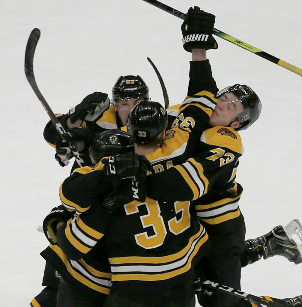 Bruins players crowd around Patrice Bergeron after his goal with 7.2 seconds left gave Boston a 4-3 win Thursday against the Florida Panthers.