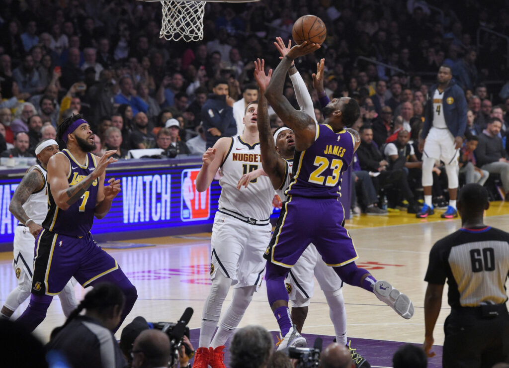 LeBron James scores the basket Wednesday night that put him past Michael Jordan and into fourth place on the NBA all-time scoring list.