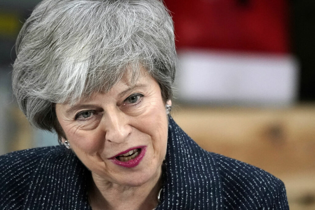 "British Prime Minister Theresa May gives a speech Friday in Grimsby, Britain. Battling to stave off a second defeat for the unpopular Brexit deal, May also implored the EU to help her make ""one more push"" to get her agreement through a skeptical British Parliament."